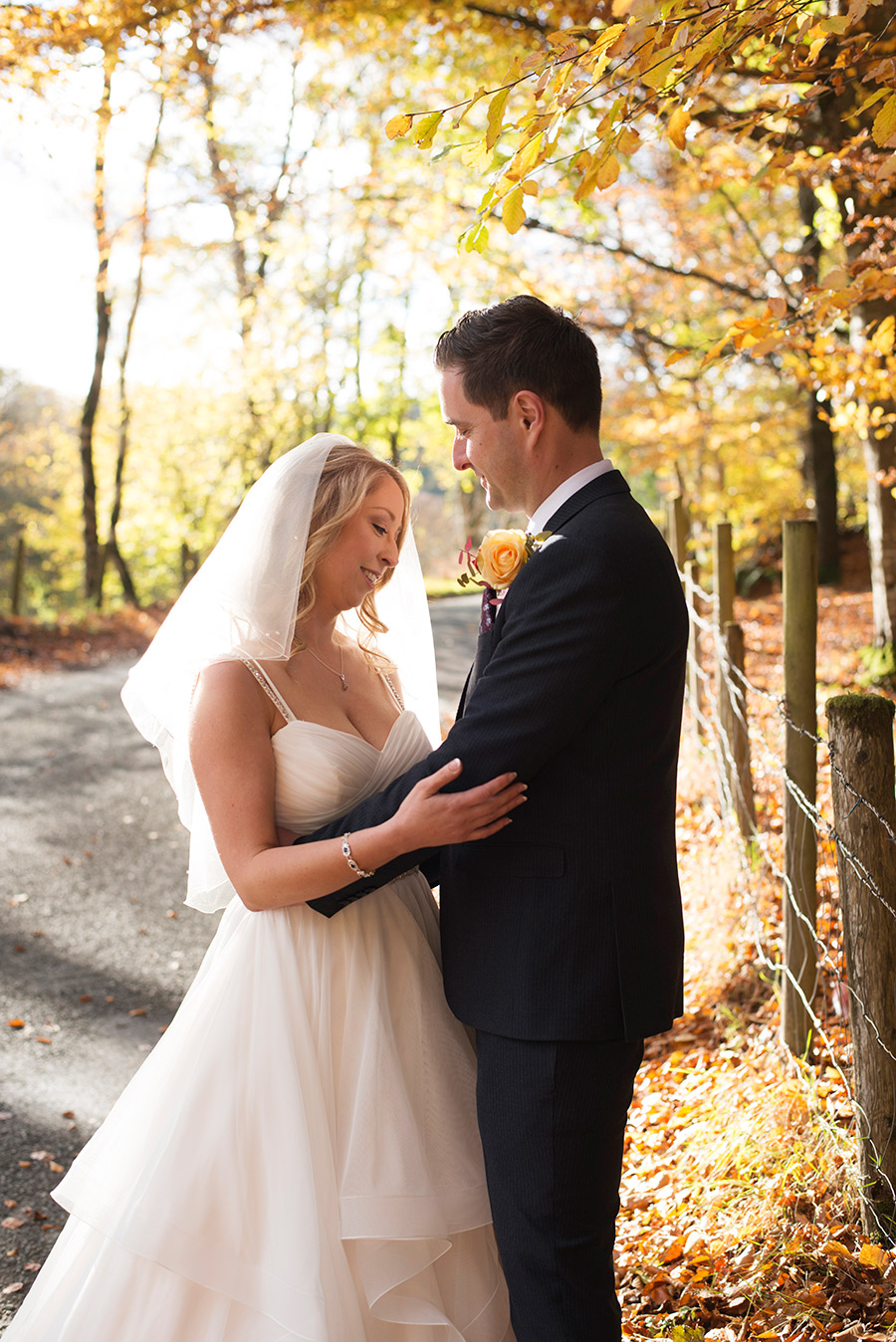 bride and groom in wicklow forest autumn colour leaves