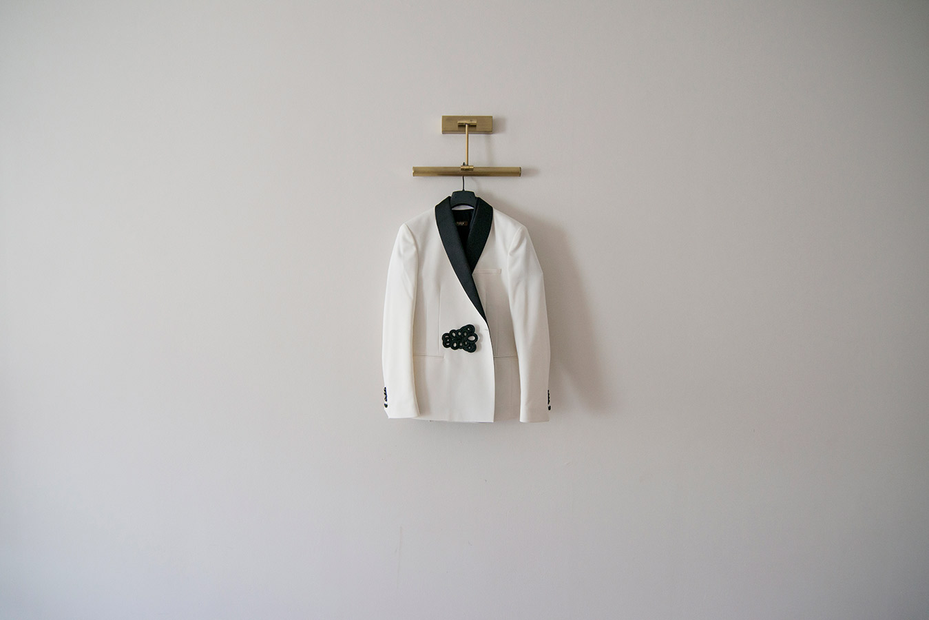 groom's white wedding suit hanging up