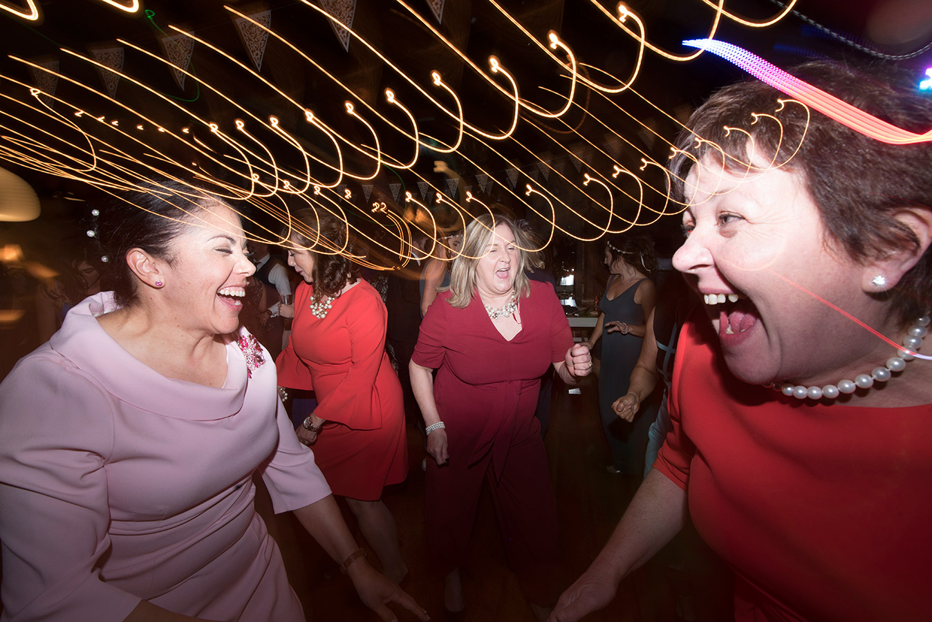 wedding guests dance and laugh on dancefloor at mount druid