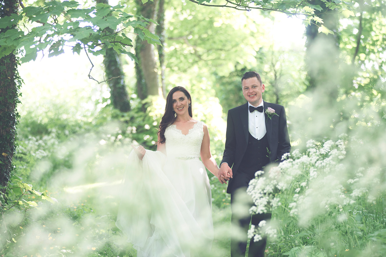 brude and groom in forest green in galway