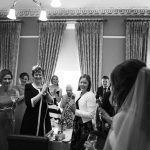 pery square guests greeting wedding photogarphy black white