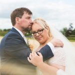 photo of bride and groom kissing in cornfield at clanard court hotel, irish weddings, couple photography