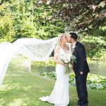 cliff at lyons weddings, lakeside photos, bride and groom, wedding veil