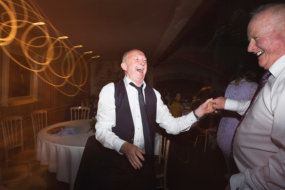 brides dad dancing at wedding at cliff at lyons