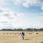 bride and groom walking in kildare cornfield, Kilkea Castle Wedding Photography