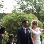 newlyweds wave to their guests at Cabra Castle Wedding
