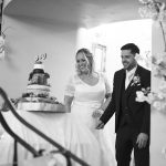 bride and groom cut their cake at Cabra Castle Wedding