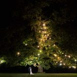 Rathsallagh House Wedding, bride and groom under rathsallagh tree nightime