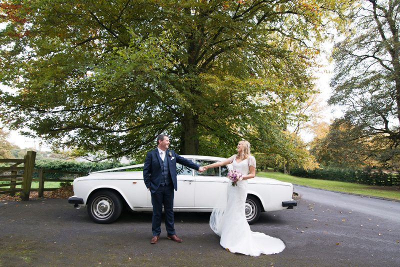 bride and groom with their wedding car at Durrow Castle Wedding