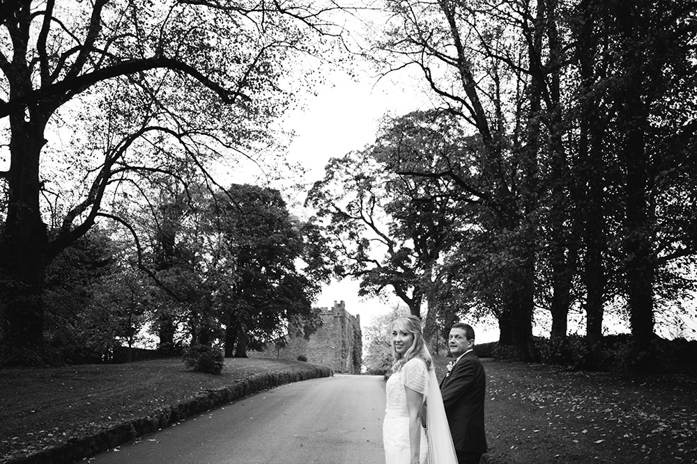 walking the driveway at castle durrow for wedding
