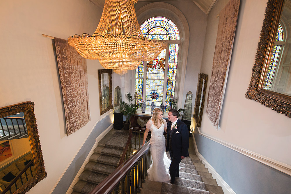 bride and groom on staricase at castle durrow wedding