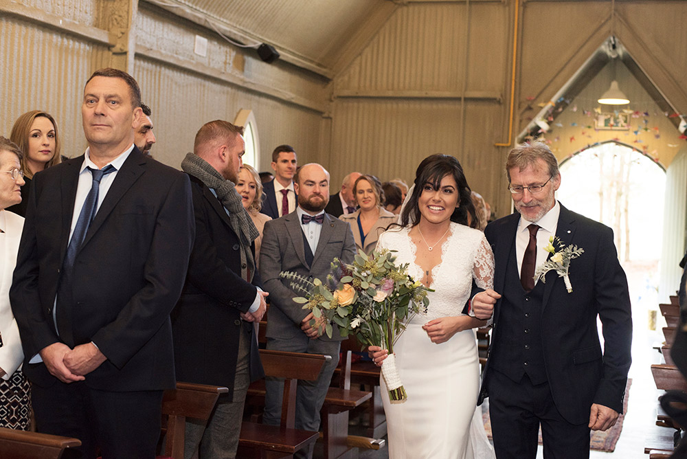 walking down the aisle at wedding for mount druid