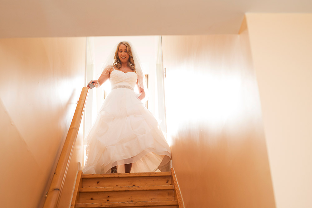 bride coming down stairs at kippure estate wedding
