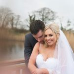 bride and groom on bridge at lake in ballymagarvey village
