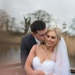 bride and groom at lake in ballymagarvey village