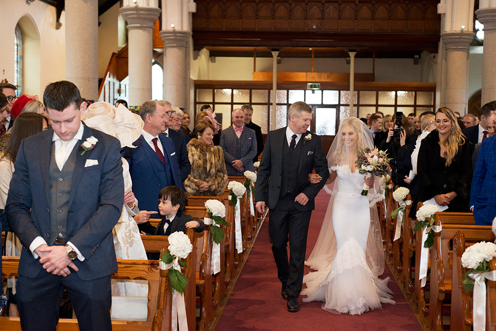 groom looks at bride for first time in clane church