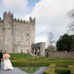 bride and groom walk in gardens of kilkea castle
