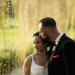 brie and groom under weeping willow at kilkea castle wedding