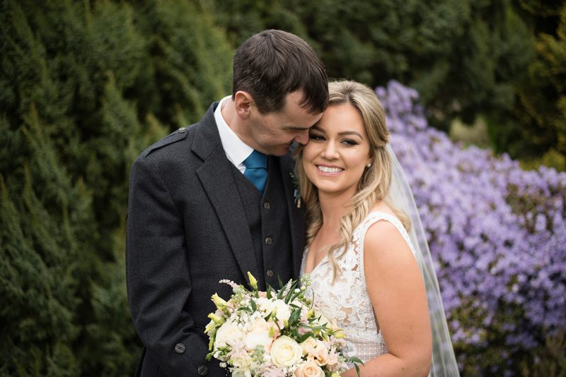 bride and groom in colourful gardens at rathsallagh summer wedding
