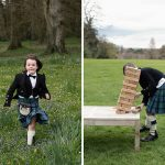 page boys in kilts play in rathsallagh gardens at summer wedding