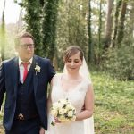 bride and groom in green forest at summerhill house wedding