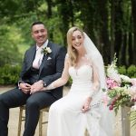 bride and groom hold hands at outdoor wedding ceremony druids glen resort