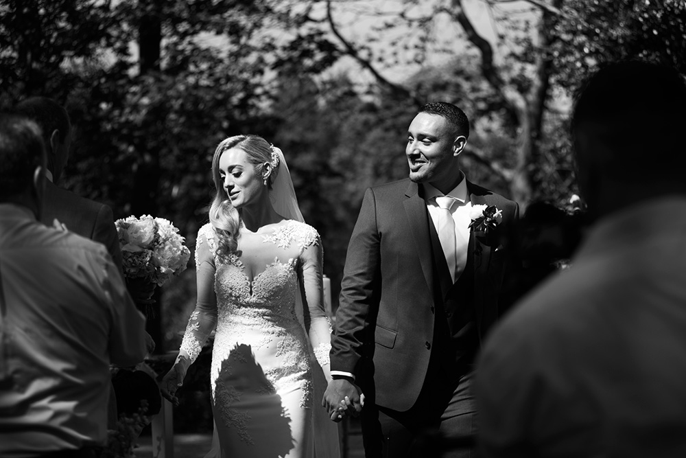 candid wedding photographer druids glen outdoor wedding ceremony
