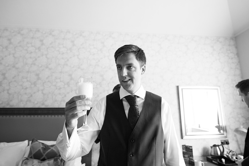 groom getting ready at druids glen hotel for wedding ceremony outside