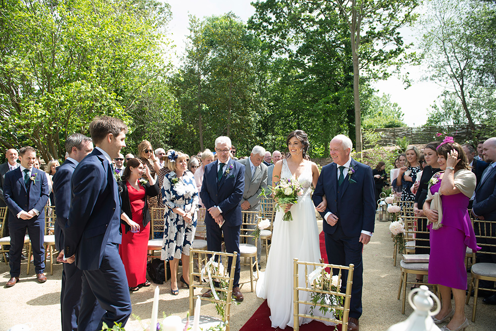 groom sees his bride for outdoor wedding ceremony at druids glen