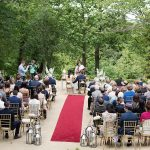 guests at outdoor wedding ceremony at druids glen summer
