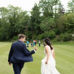 bride and groom meet golfers on druids glen golf course wedding