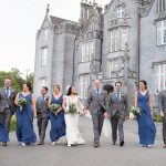 bridal party walk outside kinnity castle wedding