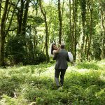 groom carries bride in kinnitty castle forest wedding