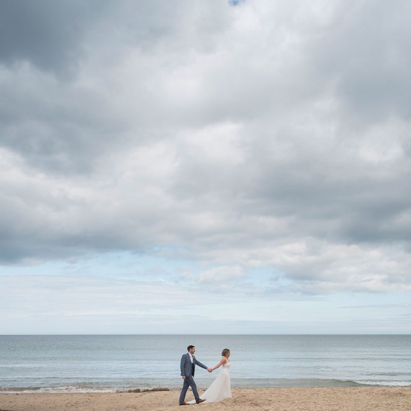 bride and groom walk on wexford beach wedding