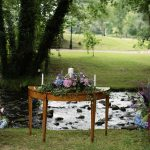 purple floral arrangement outdoor wedding ceremony brooklodge