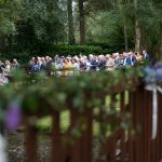 guests sitting at outdoor wedding ceremony at brooklodge