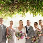 bridesmaids and groomsmen under the ivy at brooklodge wedding