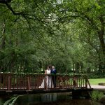 bride and groom on the bridge at brooklodge hotel wedding