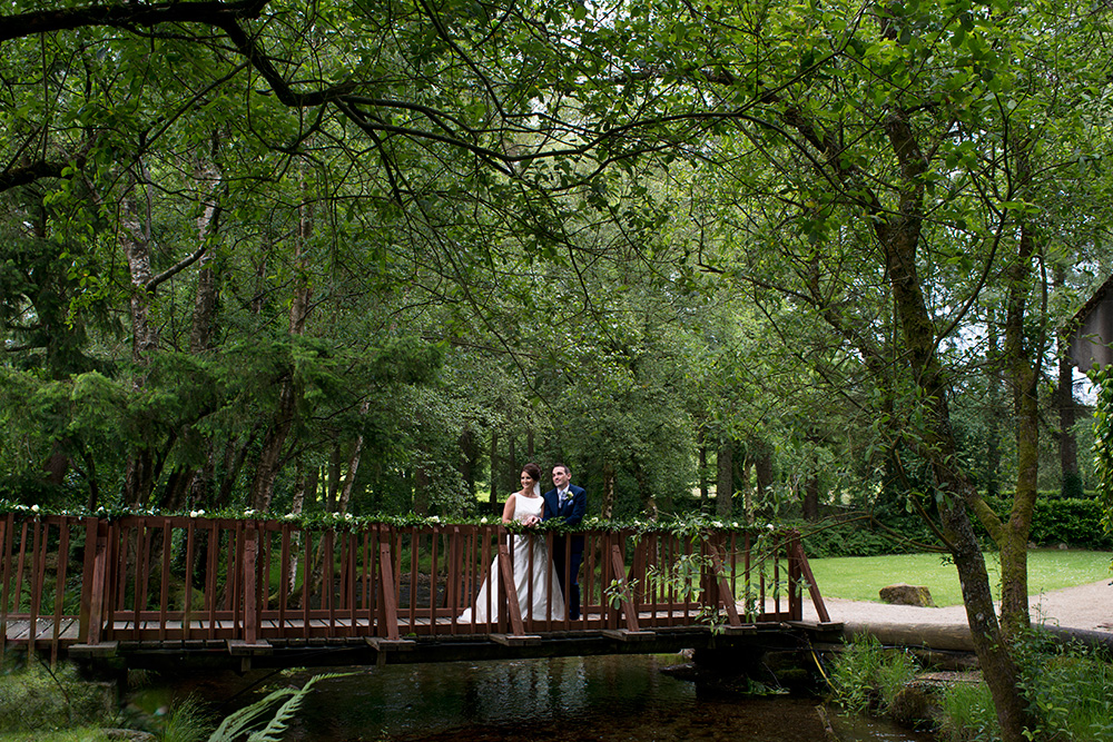 bride and groom on Brooklodge Hotel bridge