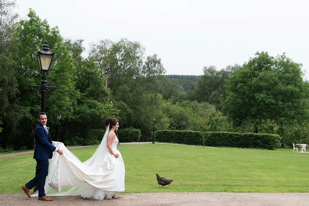 bride and groom photos on grounds of Brooklodge Hotel