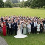 group photo of wedding guests at rtahsallagh house wedding