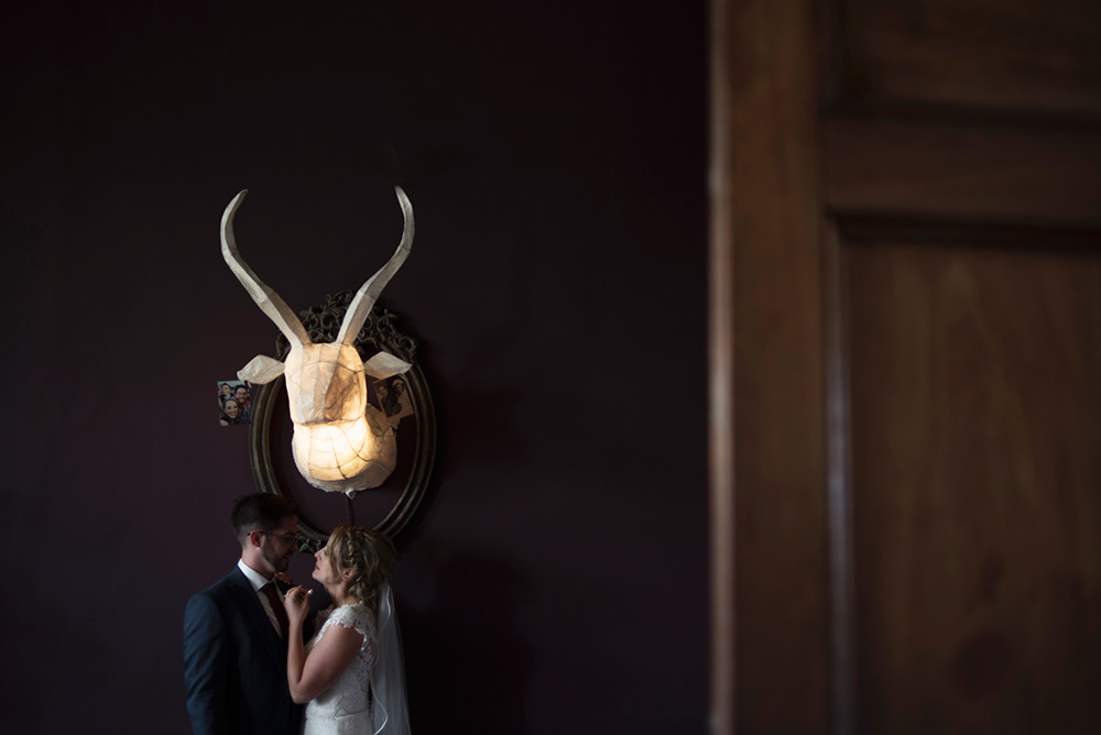 wedding couple under the moose at bellinter house wedding