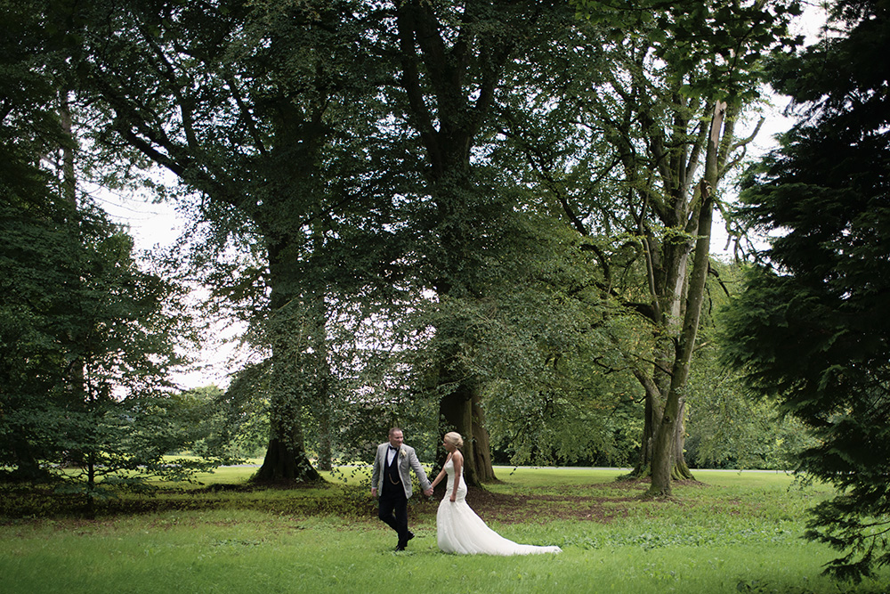 bride and groom walking in the grounds of rathsallagh house