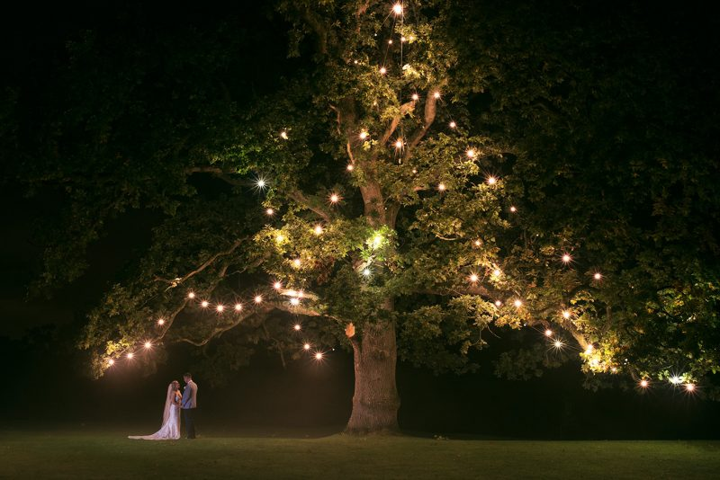 night time photo of the bride and groom at rathsallagh tree om a misty night