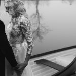 bride and groom by boat at coolbaun quay wedding photos
