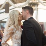 bride and groom kiss during wedding ceremony at coolbaun quay