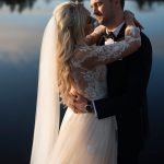 bride and groom by lake at coolbaun quay wedding