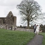 bride and groom have wedding photos taken at bective abbey