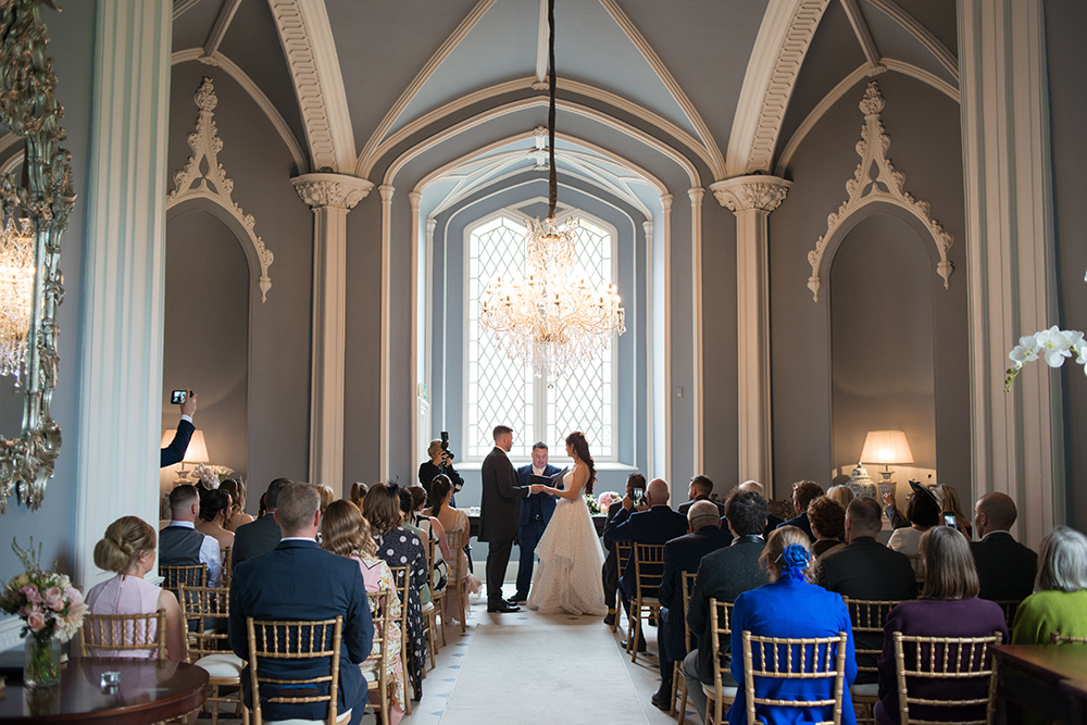 Exchanging vows in the ceremony room at Luttrellstown Castle wedding