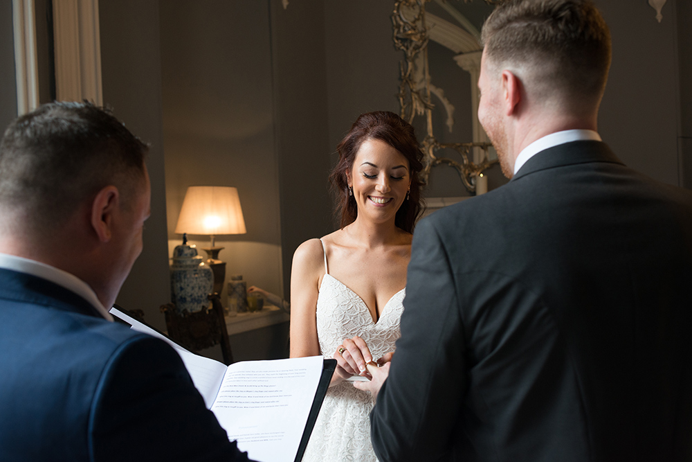 exchanging rings at wedding at Luttrellstown Castle